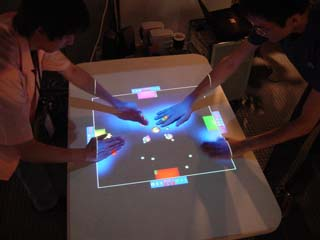 http://www.csl.sony.co.jp/person/rekimoto/smartskin/game320.jpg